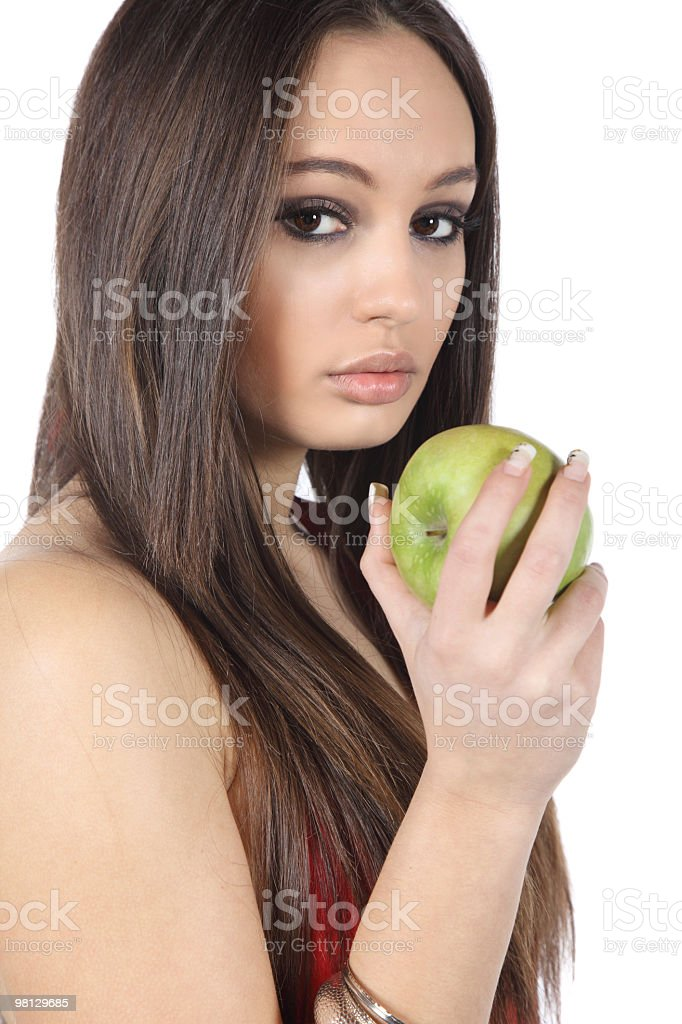 Beautiful young woman eating green apple royalty-free stock photo