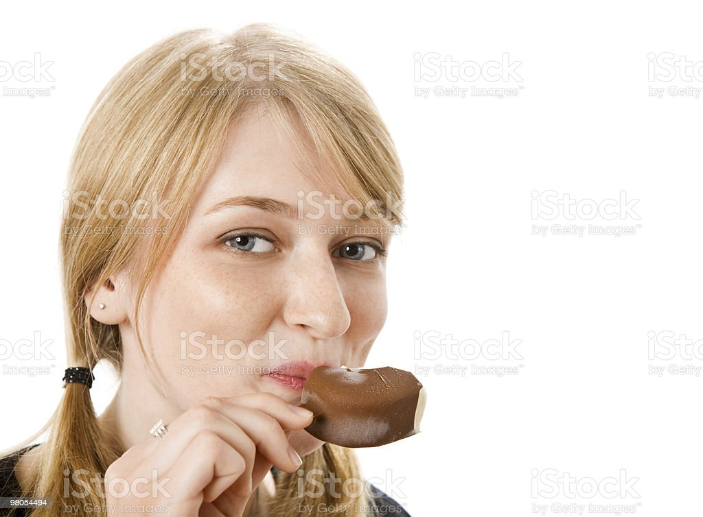 Beautiful young woman eating ice-cream royalty-free stock photo