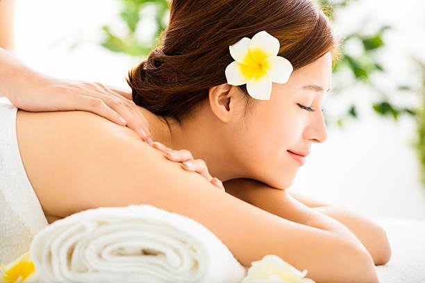 Beautiful young woman enjoy spa salon stock photo