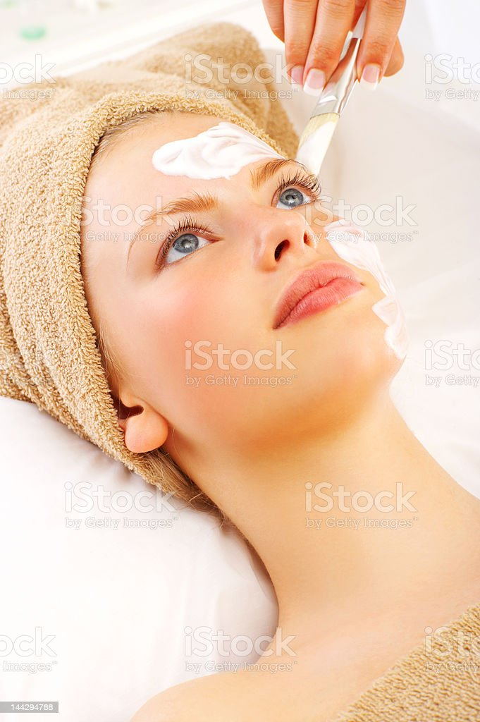 Beautiful young woman enjoying a beauty treatment royalty-free stock photo