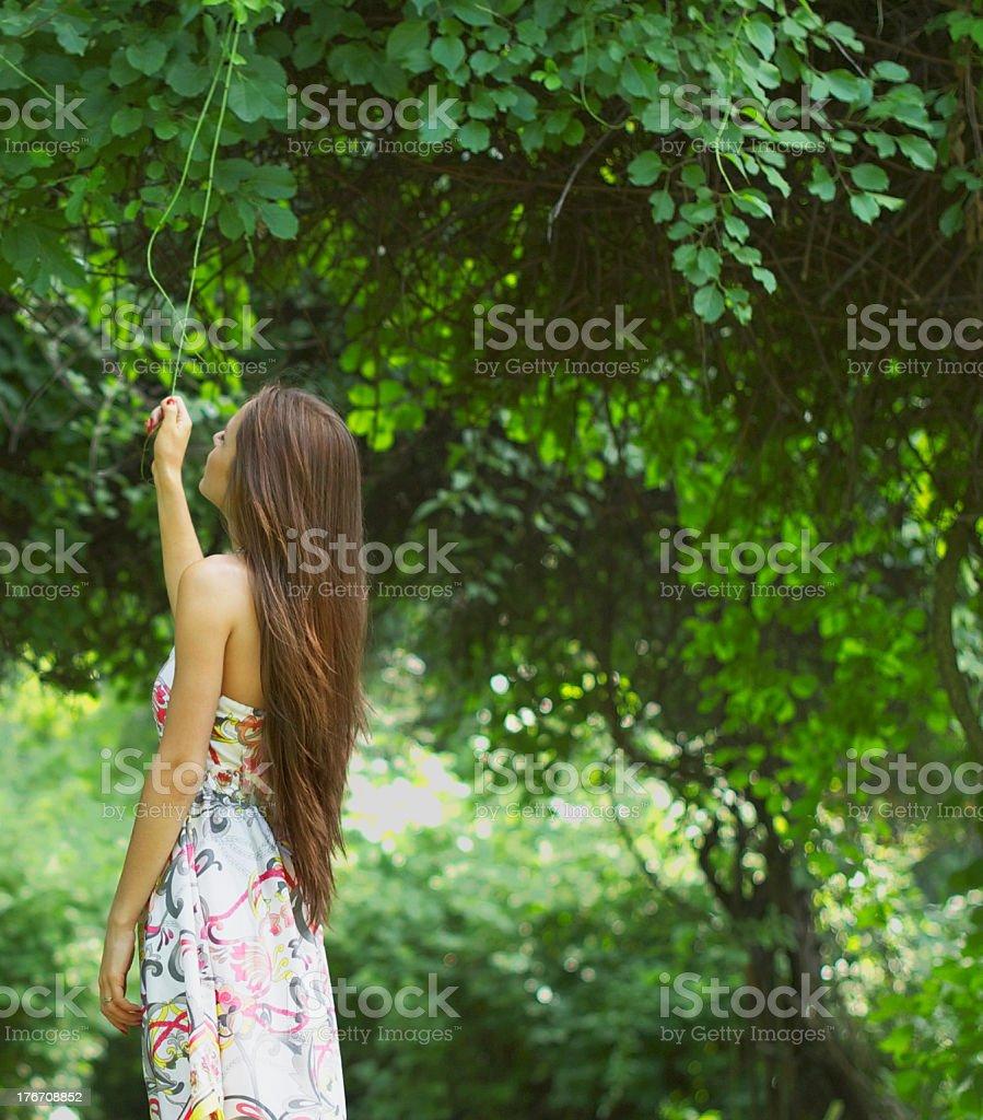 Beautiful young woman enjoying nature royalty-free stock photo