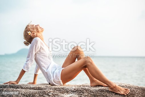 istock Beautiful young woman  enjoying the beach 535458192