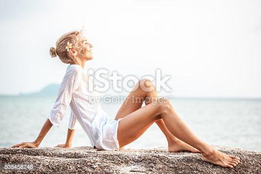 670374358 istock photo Beautiful young woman  enjoying the beach 535458246