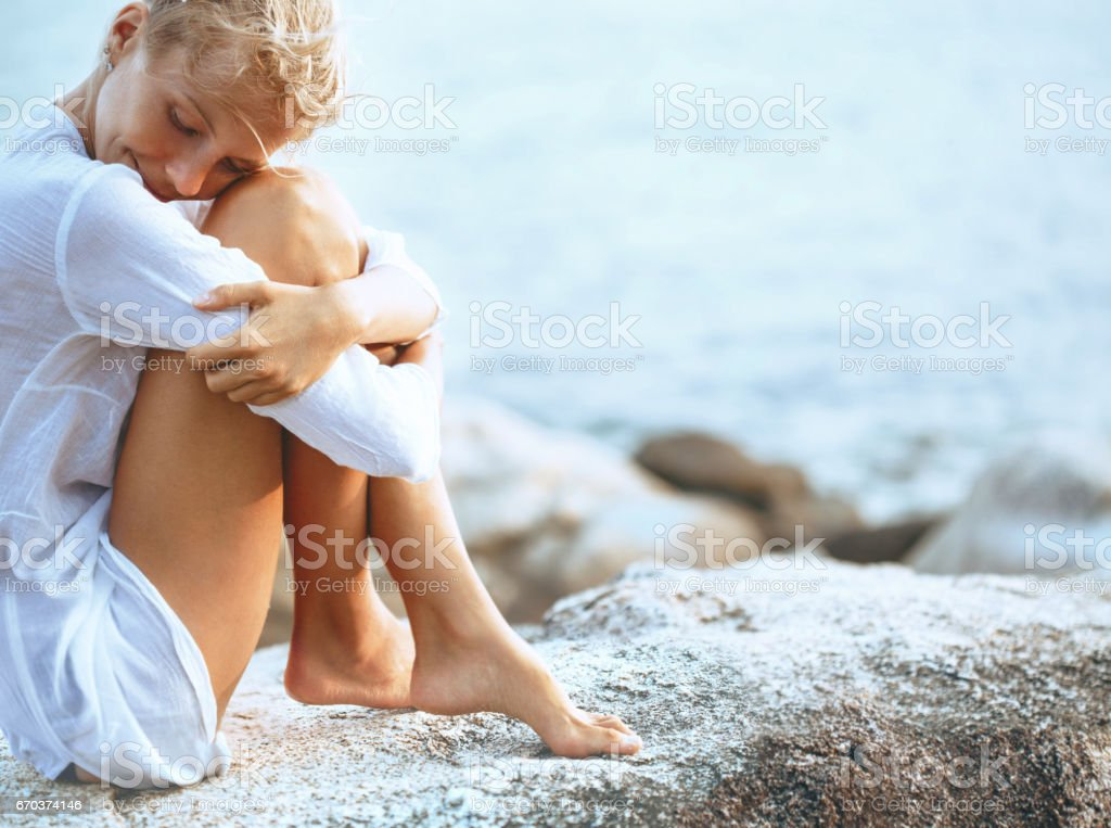 Beautiful young woman enjoying the beach stock photo