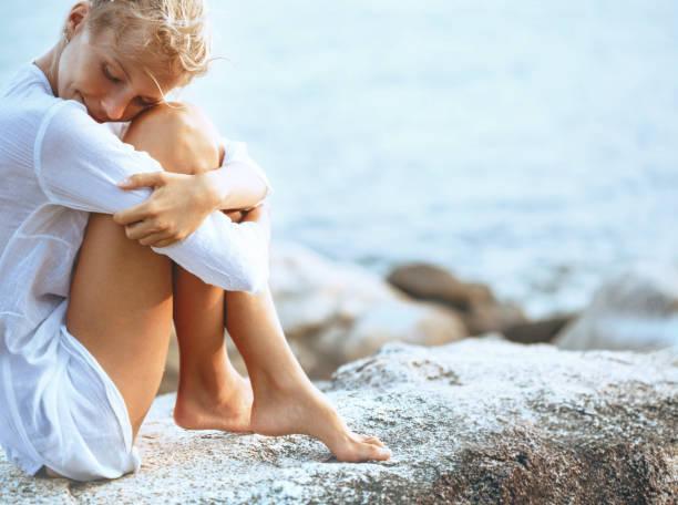 Beautiful young woman enjoying the beach stock photo