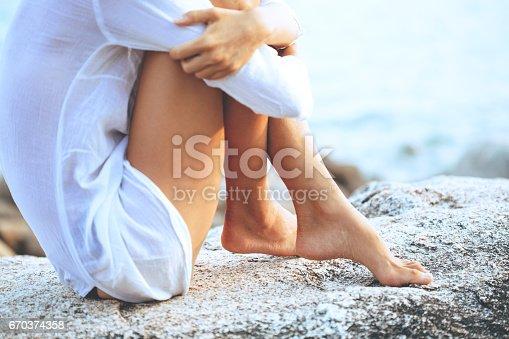 670374358 istock photo Beautiful young woman enjoying the beach 670374358