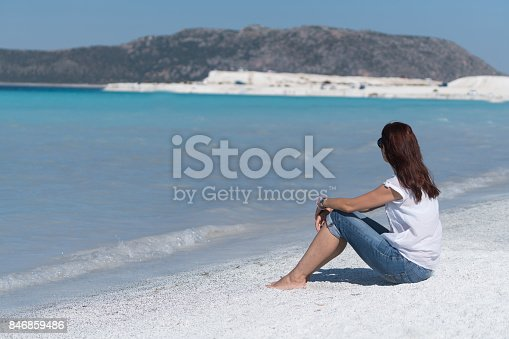 670374358 istock photo Beautiful young woman enjoying the beach 846859486