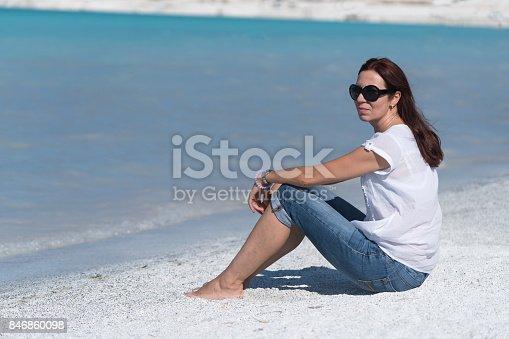 670374358 istock photo Beautiful young woman enjoying the beach 846860098
