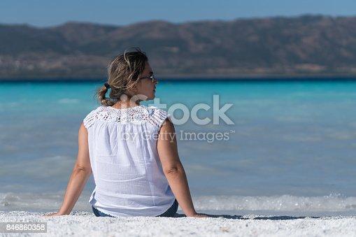 670374358 istock photo Beautiful young woman enjoying the beach 846860358