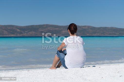 670374358 istock photo Beautiful young woman enjoying the beach 846867404