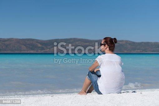 670374358 istock photo Beautiful young woman enjoying the beach 846871258