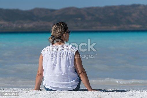 670374358 istock photo Beautiful young woman enjoying the beach 846874990