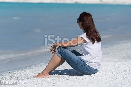 670374358 istock photo Beautiful young woman enjoying the beach 846879024
