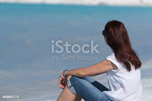 670374358 istock photo Beautiful young woman enjoying the beach 846882270
