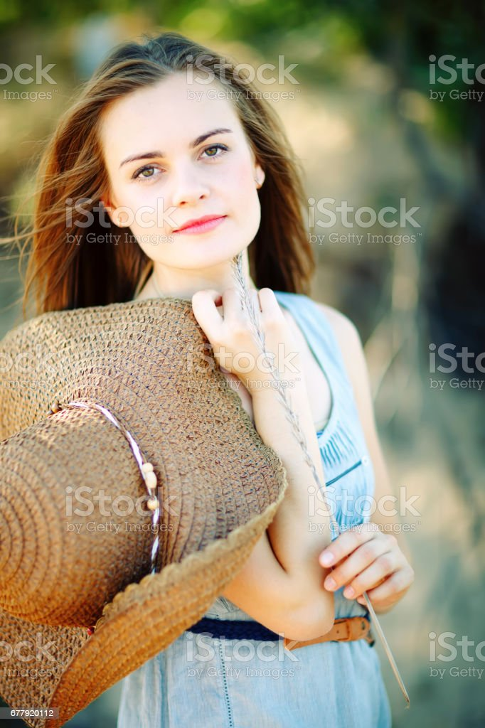 Beautiful, young woman enjoys nature in the forest royalty-free stock photo