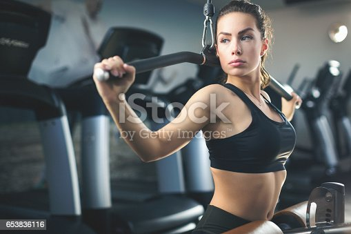 670937518istockphoto Beautiful young woman exercising at gym closeup shot 653836116