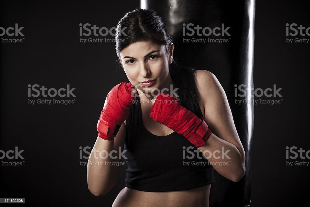 Beautiful young woman exercising in a gym royalty-free stock photo