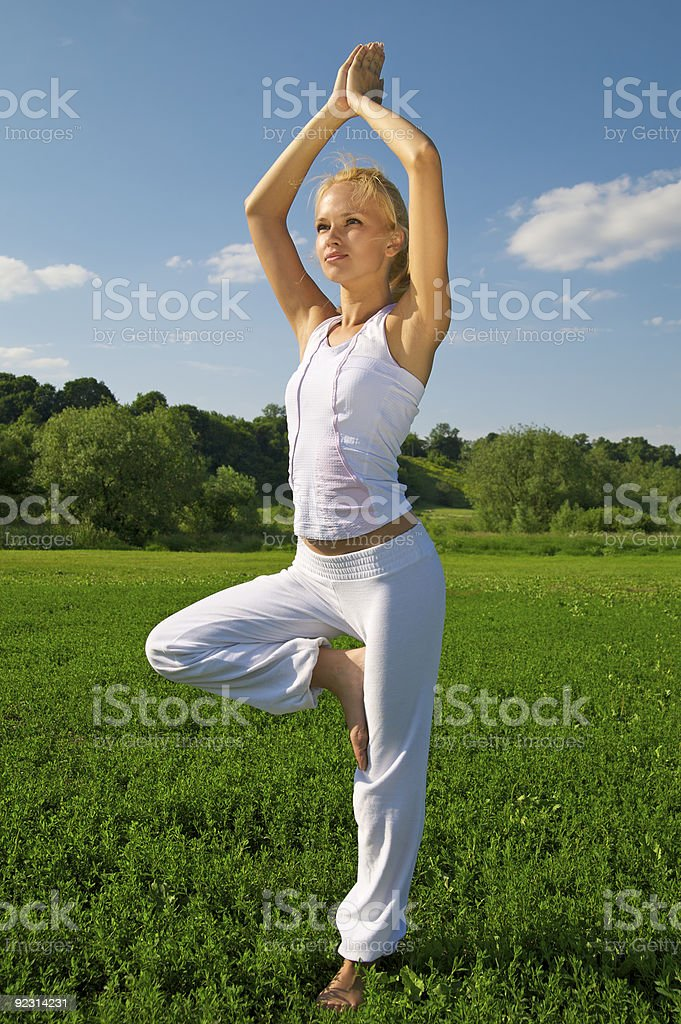 Beautiful young woman exercising outdoors royalty-free stock photo