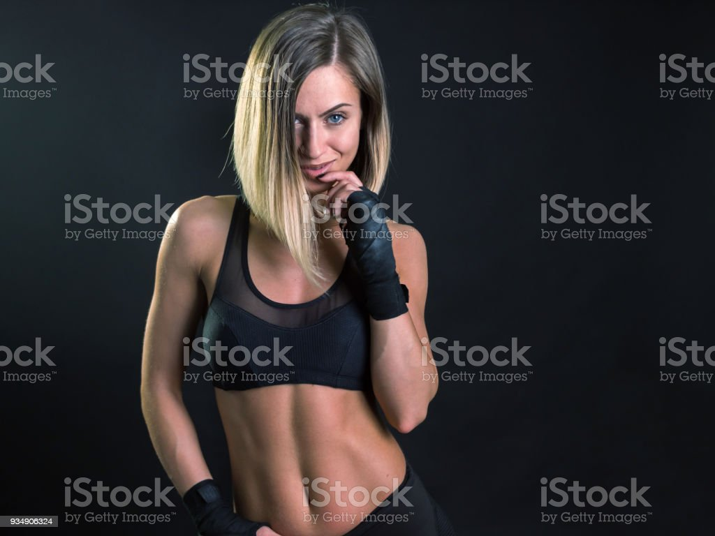 Beautiful young woman fitness model posing looking at camera stock photo
