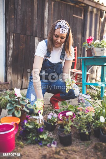 Beautiful young woman gardening in the spring time