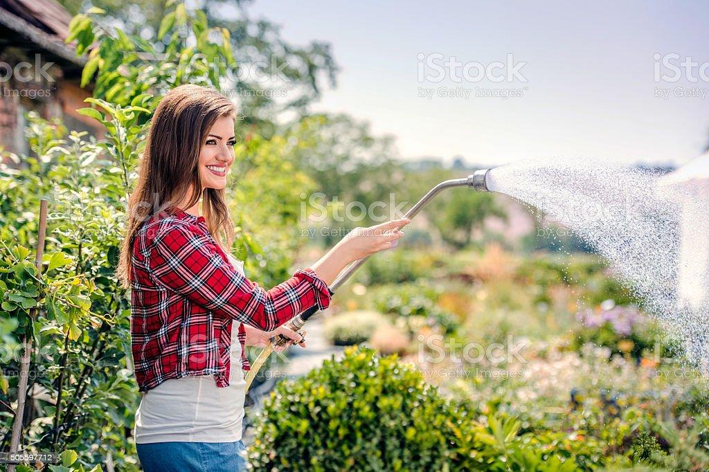 Beautiful young woman gardening stock photo