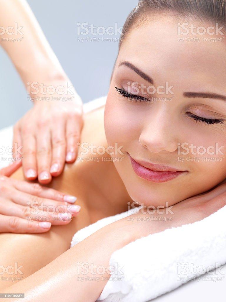 Beautiful young woman getting a massage royalty-free stock photo