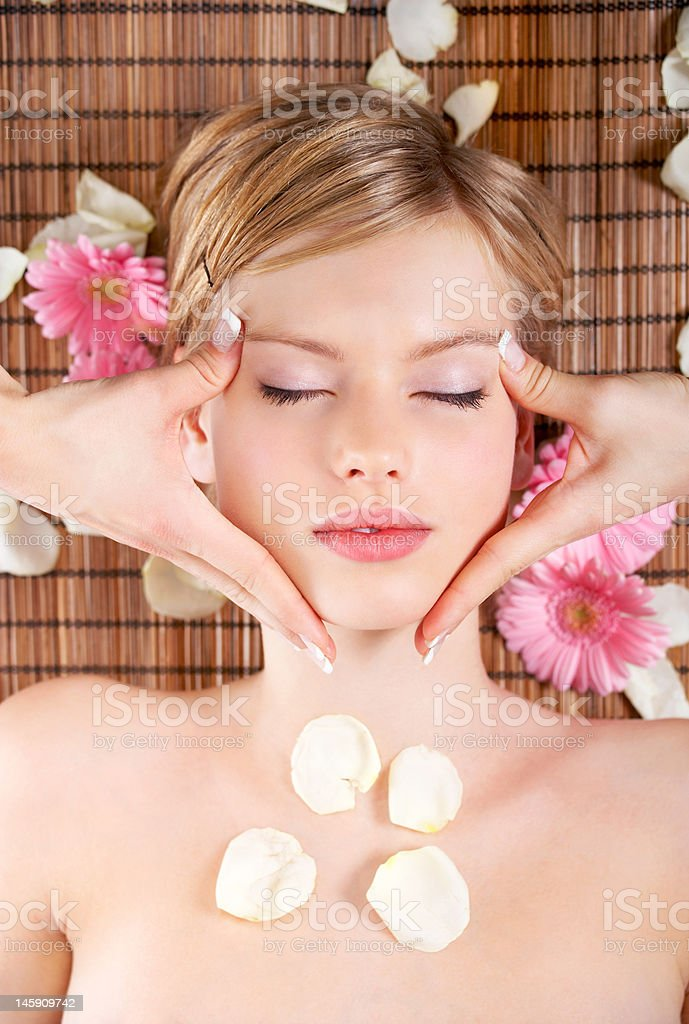Beautiful young woman getting massage at the day spa royalty-free stock photo