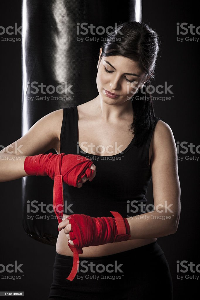 Beautiful young woman getting ready for her training royalty-free stock photo