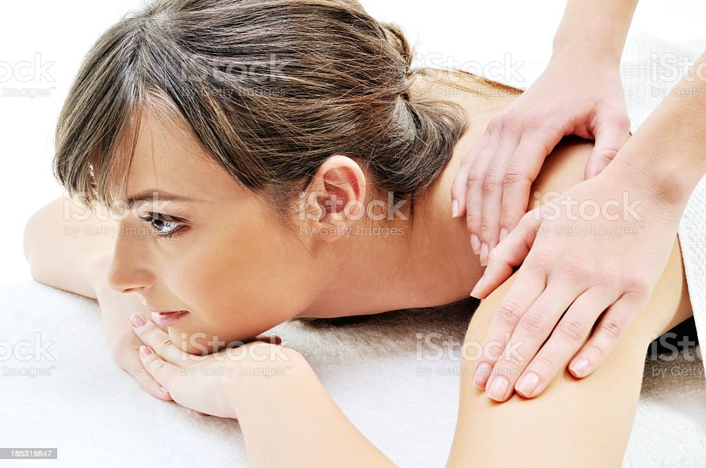 Beautiful young woman getting spa treatment royalty-free stock photo