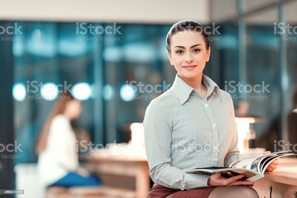 Beautiful young woman having business lunch stock photo