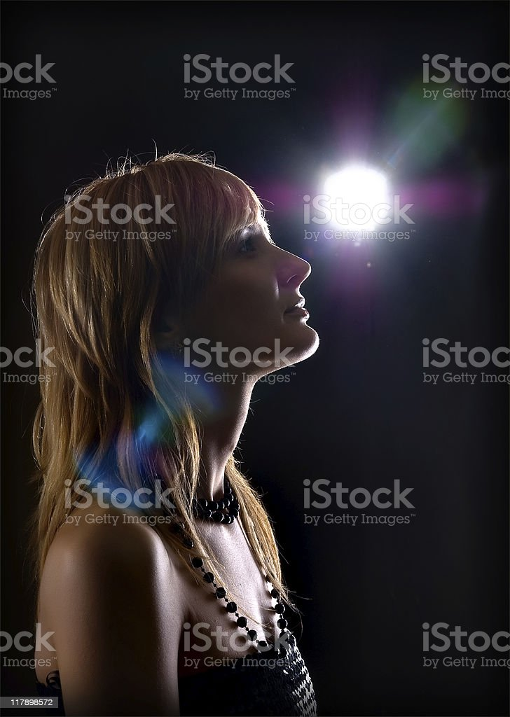beautiful  young woman high-contrast portrait in backlight royalty-free stock photo