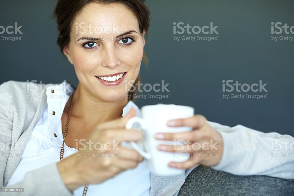 Beautiful, young woman holding a cup of coffee royalty-free stock photo