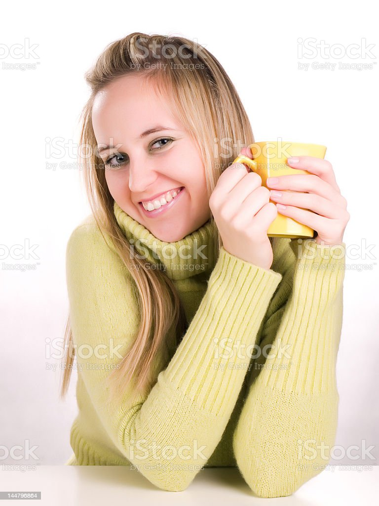 beautiful young woman holding a cup of hot drink royalty-free stock photo