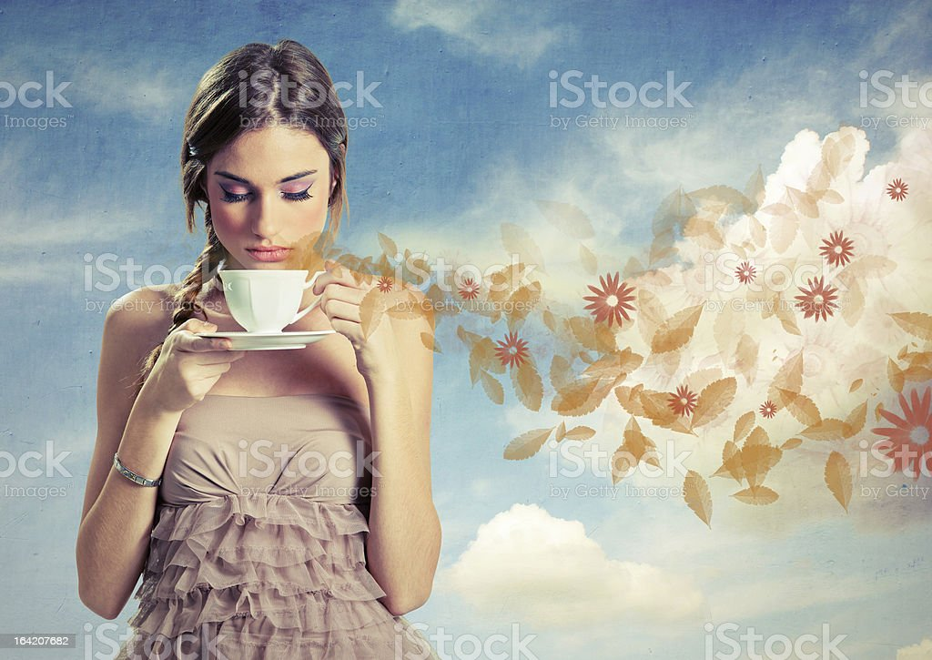 Beautiful young woman holding a cup of tea stock photo