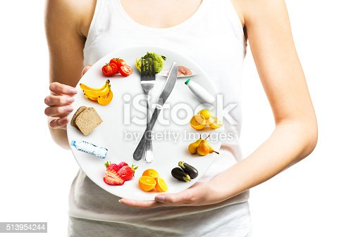 Beautiful Young Woman Holding A Plate With Food-foton och fler bilder på Balans