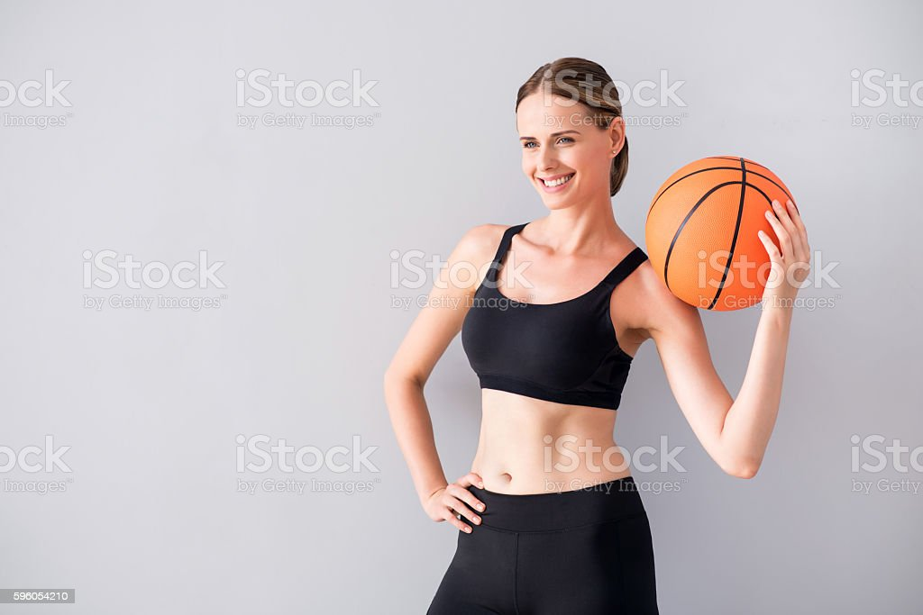 Beautiful young woman holding ball royalty-free stock photo