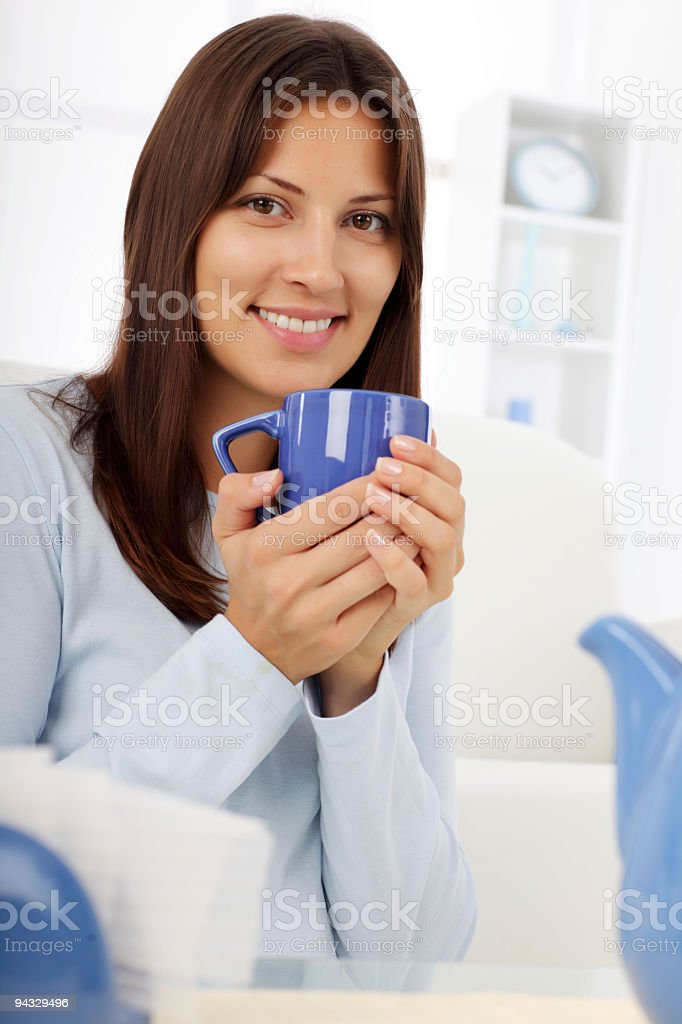 Beautiful young woman holding coffee cup. royalty-free stock photo