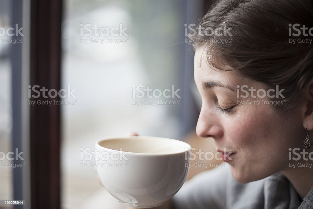 Beautiful Young Woman Holding Her Morning Cup of Coffee royalty-free stock photo