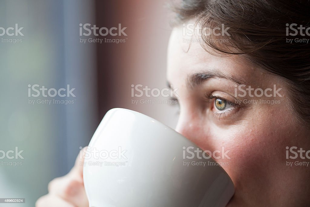 Beautiful Young Woman Holding Her Morning Cup of Coffee stock photo