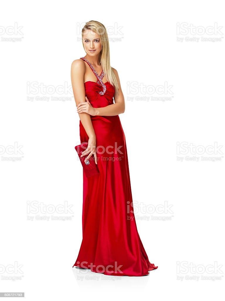 Beautiful young woman in a cocktail dress stock photo