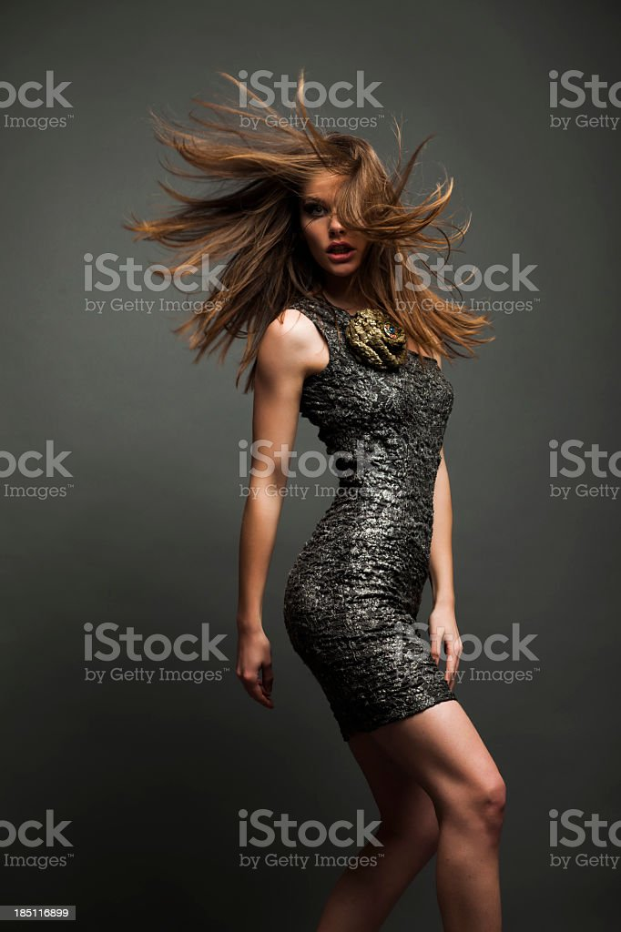 Beautiful young woman in a glamorous dress stock photo