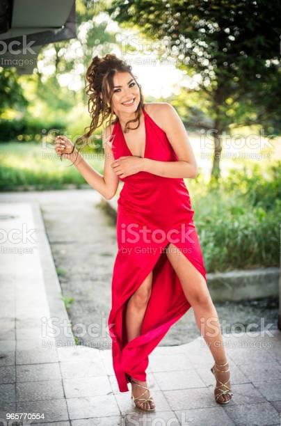Beautiful Young Woman In A Red Dress Ready For Prom Night - Fotografias de stock e mais imagens de Adulto