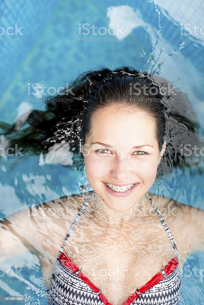 Beautiful young woman in a spa pool royalty-free stock photo
