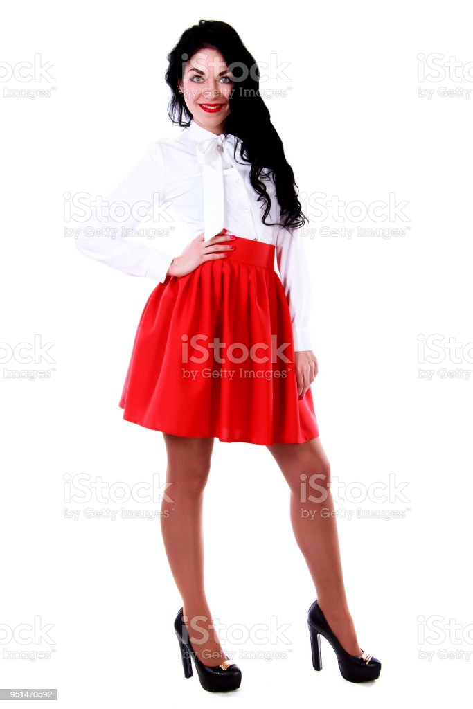 Beautiful Young Woman In A White Blouse And A Red Skirt Stock Photo