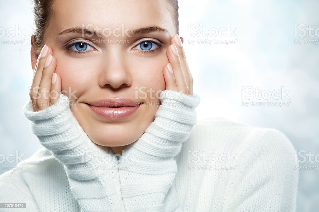 A beautiful young woman in a white sweater royalty-free stock photo