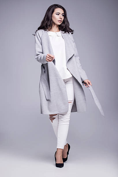 Beautiful young woman in an elegant gray coat - foto stock