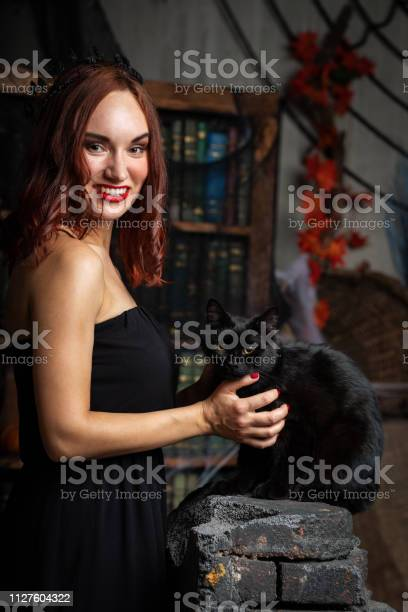 Beautiful young woman in black dress indoor picture id1127604322?b=1&k=6&m=1127604322&s=612x612&h=nhbjkjjb1rnubbsbezcwfso4pjbonruvulfnijaaaw8=