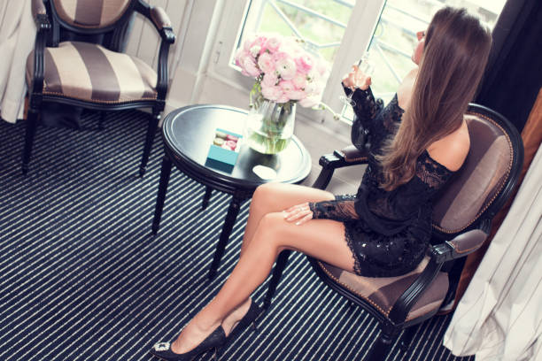 beautiful young woman in black mini dress - mini dress stock photos and pictures