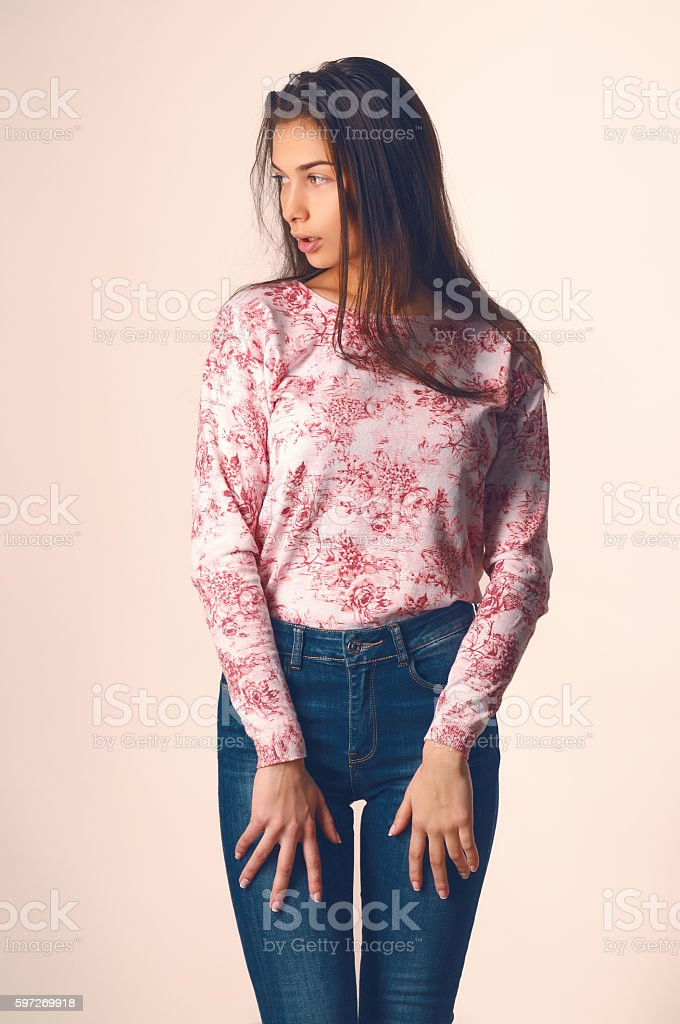 Beautiful young woman in casual clothes on a light background Lizenzfreies stock-foto