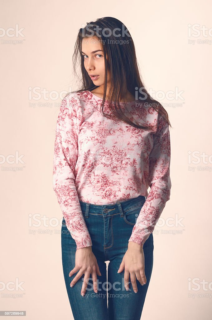 Beautiful young woman in casual clothes on a light background royalty-free stock photo